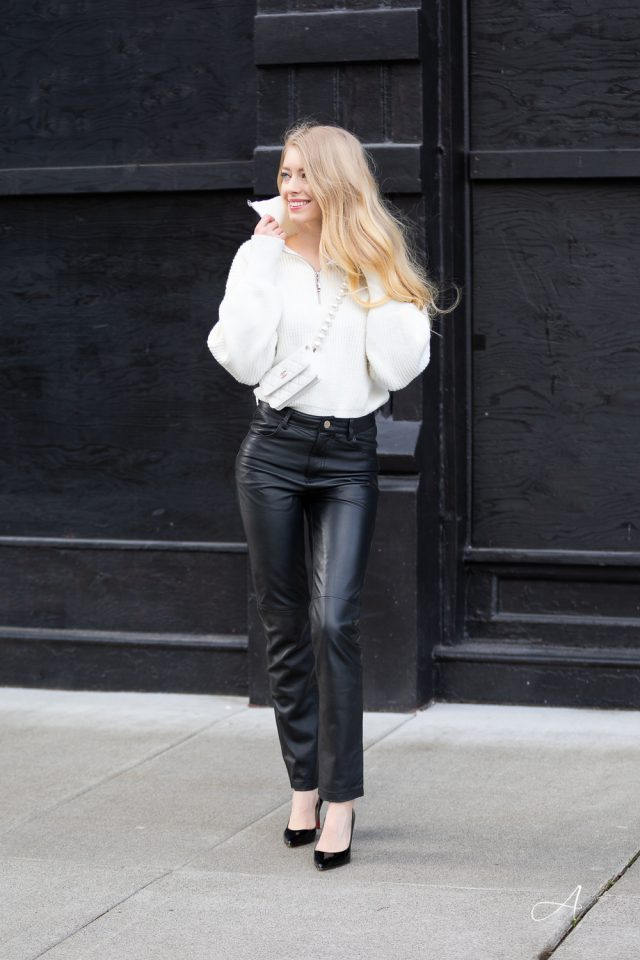 leather pants deadwood white half zip sweater chanel pearl strap bag